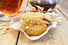Cookies oatmeal with spikelet and tea on board Stock Photo