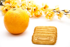 Cookies with orange and flowering branch Stock Image
