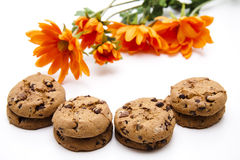 Cookies and orange flowers Stock Image