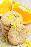 Cookies and orange fruit Stock Images