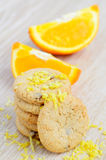 Cookies and orange fruit Stock Image