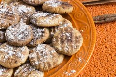 Cookies on orange plate. Homemade cookies on orange plate Royalty Free Stock Photography