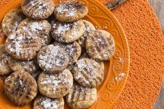 Cookies on orange plate. Homemade cookies on orange plate Royalty Free Stock Photo
