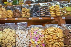 Cookies packed in clear plastic bags standing on a shelve at a stall in Thailand royalty free stock photos