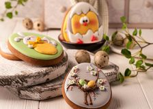 Cookies with painted easter bunny and chicken in bowl near quail eggs stock photos