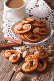 Cookies Palmiers and coffee with milk close-up, vertical Stock Image