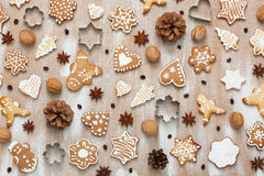 Cookies pattern with walnuts, coffee beans, anise and cookie cut. Cookies pattern with walnuts, cones, coffee beans, anise stars and cookie cutter Royalty Free Stock Photography