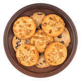 Cookies with peanuts and chocolate in a brown plate. Isolated on Royalty Free Stock Photo