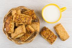 Cookies with peanuts and sesame in basket and milk Stock Photos
