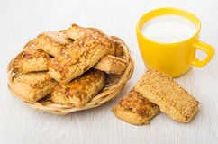 Cookies with peanuts and sesame in wicker basket, milk Stock Images