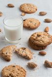 Cookies pile with chocolate chip and almond on light textile background. Delicious morning snacks for breakfast, brunch Royalty Free Stock Photo