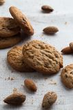 Cookies pile with chocolate chip and almond on light textile background. Delicious morning snacks for breakfast, brunch Royalty Free Stock Photos