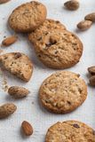 Cookies pile with chocolate chip and almond on light textile background. Delicious morning snacks for breakfast, brunch. And lunch. Appetizing, healthy and fast Royalty Free Stock Photo