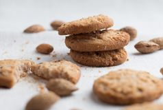 Cookies pile with chocolate chip and almond on light textile background. Delicious morning snacks for breakfast, brunch Royalty Free Stock Images