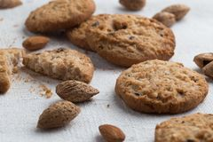 Cookies pile with chocolate chip and almond on light textile background. Delicious morning snacks for breakfast, brunch Royalty Free Stock Image