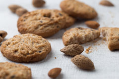 Cookies pile with chocolate chip and almond on light textile Royalty Free Stock Images