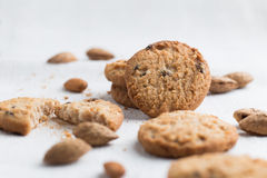 Cookies pile with chocolate chip and almond on light textile Royalty Free Stock Photos
