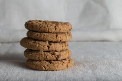 Cookies pile with chocolate chip on light textile background. Delicious morning snacks for breakfast, brunch and lunch Royalty Free Stock Images