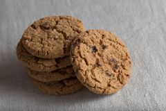 Cookies pile with chocolate chip on light textile background. Delicious morning snacks for breakfast, brunch and lunch Stock Photography
