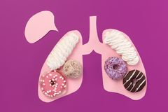 Cookies on pink lungs. Unhealthy nutrition concept. Conceptual composition with copyspace royalty free stock photography