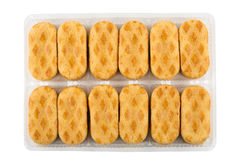 Cookies in plastic box isolated on white background Royalty Free Stock Images