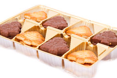 Cookies. In plastic box on white background Royalty Free Stock Photos