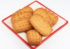 Cookies on plate. Delicious cookies on a square red and white plate. Image isolated on white background Royalty Free Stock Images