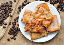 Cookies in plate  with coffee beans Royalty Free Stock Photography