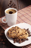 Cookies in plate and coffee cup Stock Photos