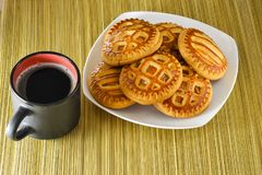 Cookies on a plate and a cup of black coffee. Stock Image