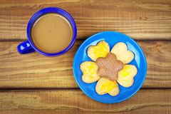 Cookies on a plate and a cup of coffee Stock Image
