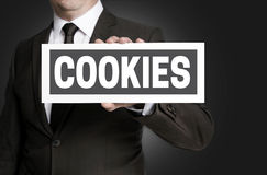 Cookies plate is held by businessman Stock Photo