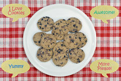 Cookies on plate with speech bubbles Royalty Free Stock Image