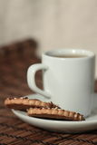 A cup of tea and cookies on a plate Stock Photos