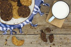 Cookies platter and glass of milk on wooden background. stock photography