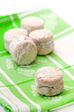 Cookies with powder sugar on a green rag Stock Photo