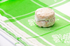 Cookies with powder sugar on a green rag Royalty Free Stock Image