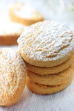 Cookies with powdered sugar. On white wooden board royalty free stock images