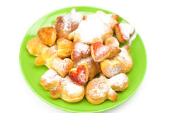 Cookies with powdered sugar on a plate Royalty Free Stock Images