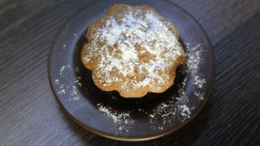 Cookies with powdered sugar on wooden table royalty free stock photo