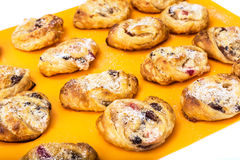 Cookies of puff pastry with apple jam and raisins Stock Photos