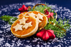 Cookies from puff pastry with jam. On the background of Christmas decorations. Selective focus Stock Images
