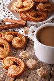 Cookies of puff pastry Palmiers and coffee with milk close-up, v Royalty Free Stock Photo