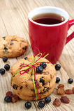 Cookies with raisins and blueberries and cup of tea Stock Photos
