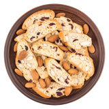Cookies with raisins and nuts in a ceramic plate. Isolated on wh Royalty Free Stock Image