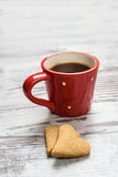 Cookies and red coffee cup. Stock Photos