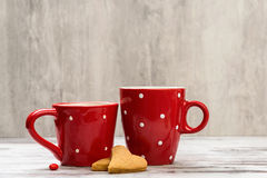 Cookies and red coffee cup. Stock Photography