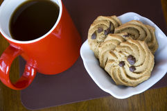 Cookies and red cup coffee Stock Photography