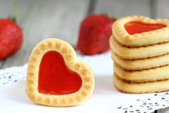 Cookies with red heart. Cookies with a heart of jelly Shallow DOF royalty free stock photo