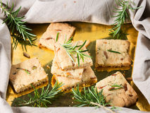 Cookies with rosemary and pignoli nuts on golden tray Royalty Free Stock Image